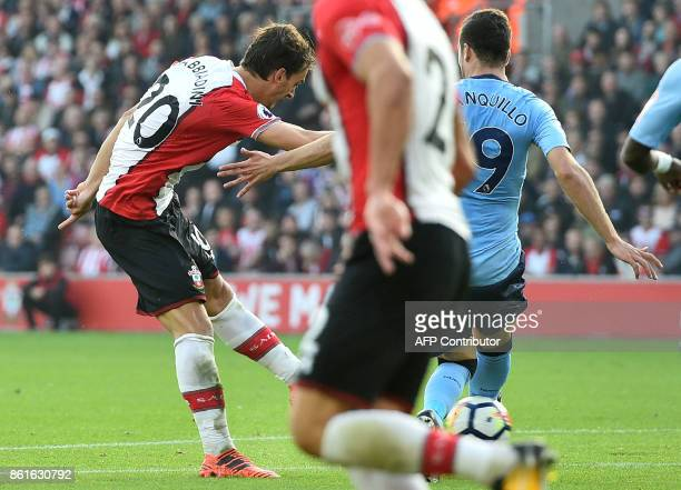 Southampton's Italian striker Manolo Gabbiadini scores their first goal to equalise during the English Premier League football match between Watford...