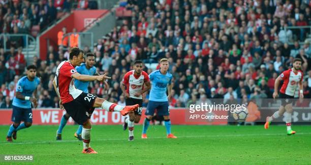 Southampton's Italian striker Manolo Gabbiadini scores their second goal from the penalty spot to equalise 22 during the English Premier League...