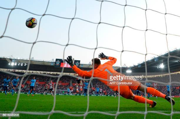 Southampton's Italian striker Manolo Gabbiadini scores their second goal from the penalty spot during the English Premier League football match...