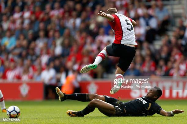 Southampton's Jack Stephens and Swansea City's Jordan Ayew battle for the ball during the Premier League match at St Mary's Stadium Southampton