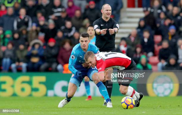 Southampton's James WardProwse and Granit Xhaka during the Premier League match between Southampton and Arsenal at St Mary's Stadium on December 10...