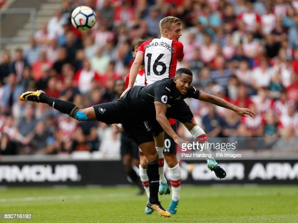 Southampton's James WardProwse and Swansea City's Wayne Routledge battle for the ball during the Premier League match at St Mary's Stadium Southampton