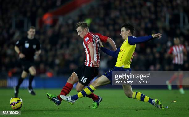 Southampton's James WardProwse is tackled by Arsenal's Laurent Koscielny