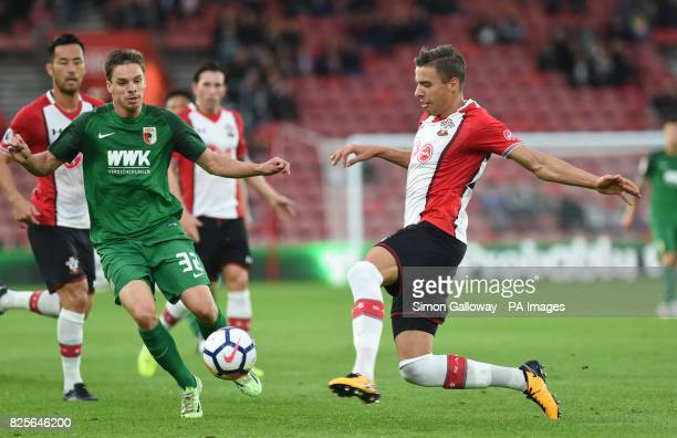 Southampton's Jan Bednarek and Augsburg's Raphael Framberger battle for the ball during the preseason friendly match at St Mary's Southampton