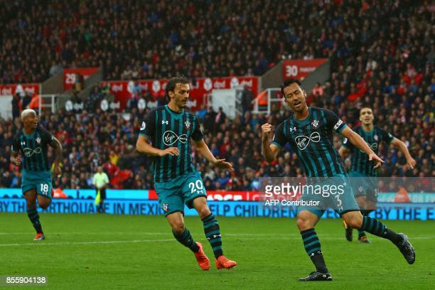 Southampton's Japanese defender Maya Yoshida celebrates after scoring their first goal during the English Premier League football match between Stoke...