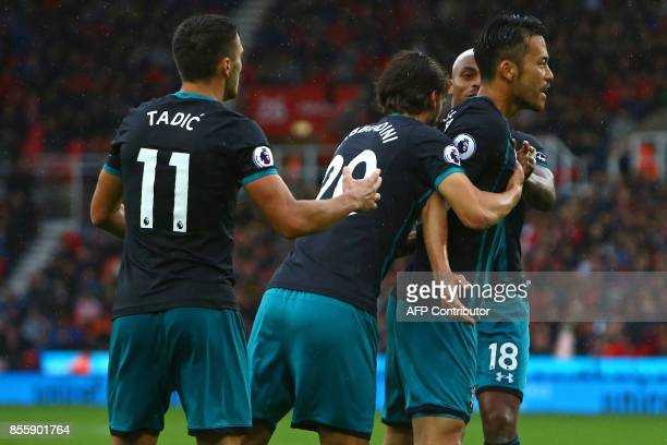 Southampton's Japanese defender Maya Yoshida celebrates with teammates after scoring their first goal during the English Premier League football...