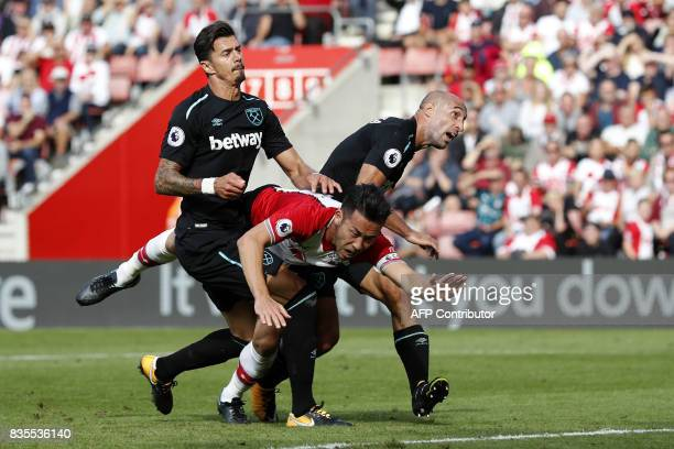 Southampton's Japanese defender Maya Yoshida is fouled by West Ham United's Argentinian defender Pablo Zabaleta during the English Premier League...