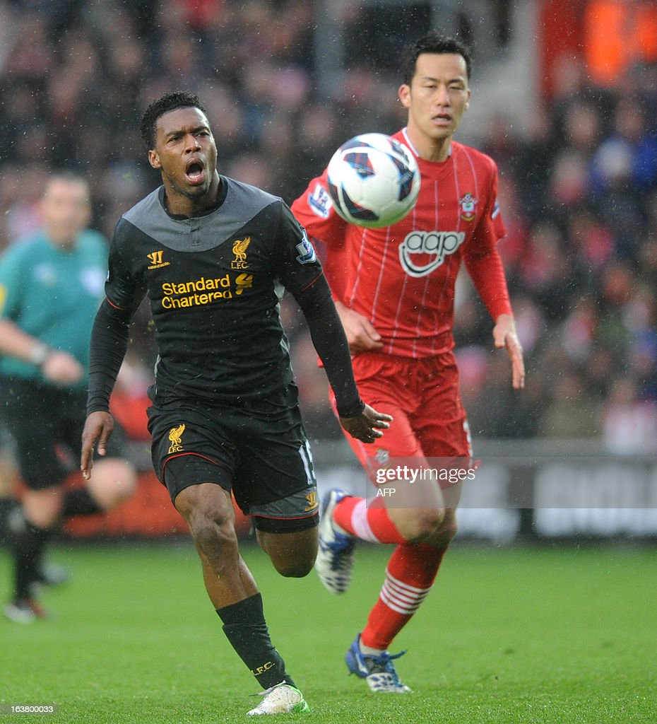 """Southampton's Japanese defender Maya Yoshida (R) vies with Liverpool's English player Daniel Sturridge during the English Premier League football match between Southampton and Liverpool at St Mary's Stadium in Southampton on March 16, 2013. AFP PHOTO/ Olly GREENWOOD - RESTRICTED TO EDITORIAL USE. No use with unauthorized audio, video, data, fixture lists, club/league logos or """"live"""" services. Online in-match use limited to 45 images, no video emulation. No use in betting, games or single club/league/player publications."""