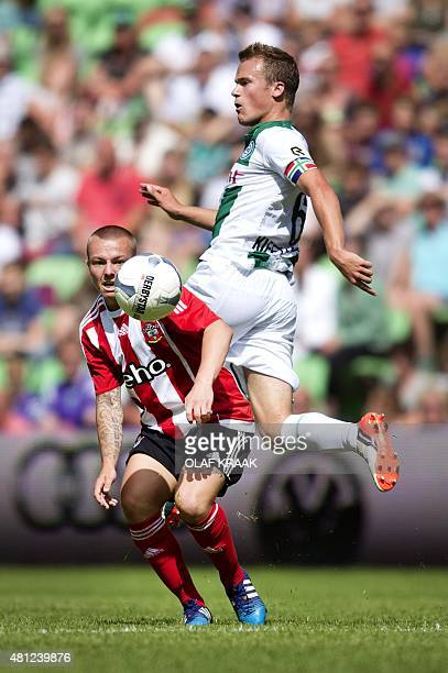 Southampton's Jordy Clasie vies for the ball to FC Groningen's Maikel Kieftenbeld during a friendly foootball match between Groningen and Southampton...