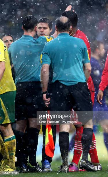Southampton's manager Mauricio Pochettino approaches match officials and referee Mike Clattenburg after the Barclays Premier League match at Carrow...