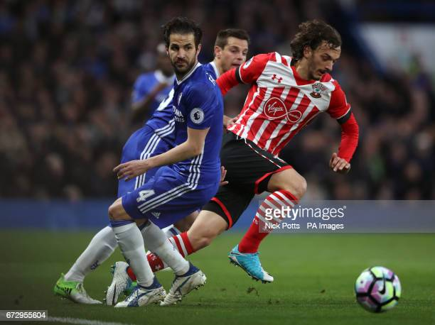 Southampton's Manolo Gabbiadini and Chelsea's Cesc Fabregas battle for the ball during the Premier League match at Stamford Bridge London