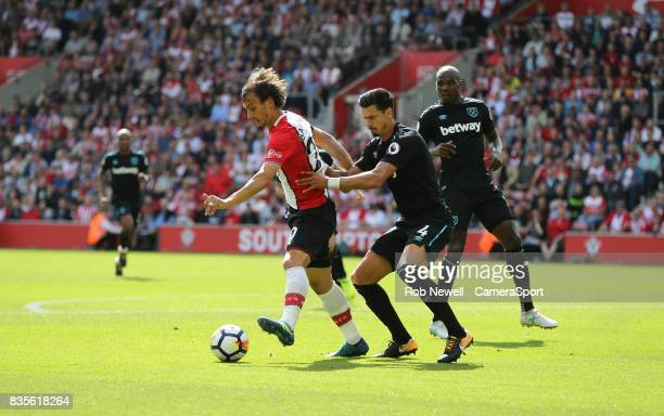 Southampton's Manolo Gabbiadini and West Ham United's Jose Fonte during the Premier League match between Southampton and West Ham United at St Mary's...