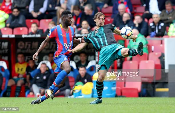 Southampton's Manolo Gabbiadini has his shirt pulled Timothy FosuMensah during the Premier League match between Crystal Palace and Southampton at...