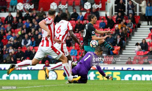 Southampton's Manolo Gabbiadini is denied by Stoke goalkeeper Jack Butland during the Premier League match between Stoke City and Southampton at the...