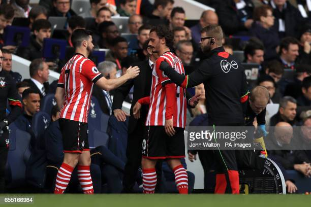 Southampton's Manolo Gabbiadini is substituted for team mate Shane Long during the Premier League match at White Hart Lane London