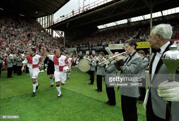 Southampton's Matthew Le Tissier and Francis Benali lead out the teams as a brass band plays at the last ever match at The Dell