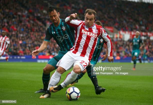 Southampton's Maya Yoshida and Stoke City's Xherdan Shaqiri battle for the ball during the Premier League match at the bet365 Stadium Stoke