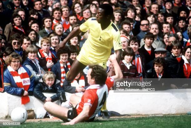Southampton's Mike McCartney slides in on Tottenham Hotspur's Garth Crooks