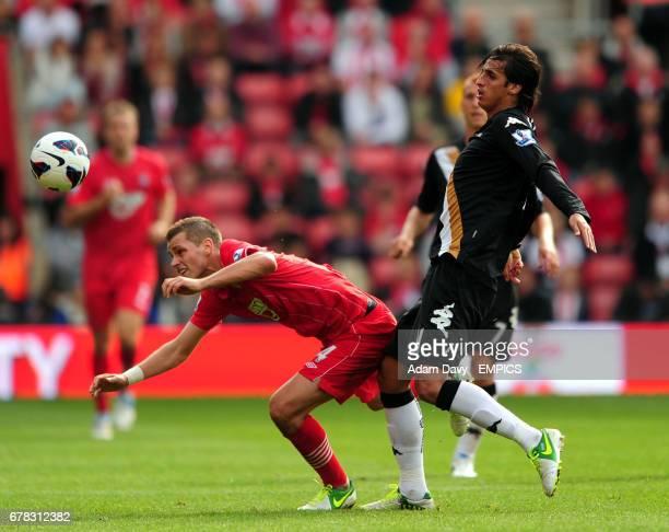 Southampton's Morgan Schneiderlin and Fulham's Bryan Ruiz battle for the ball