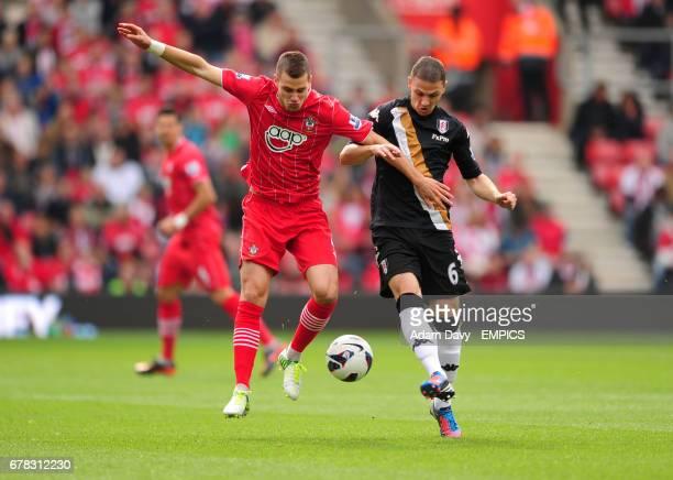 Southampton's Morgan Schneiderlin and Fulham's Chris Baird battle for the ball