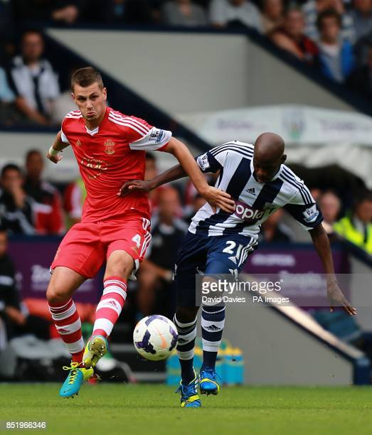 Southampton's Morgan Schneiderlin and West Bromwich Albion's Youssouf Mulumbu battle for the ball
