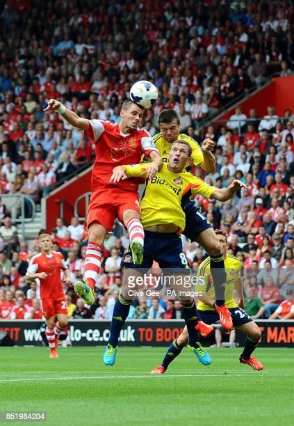 Southampton's Morgan Schneiderlin Sunderland's Craig Gardner and Ondrej Celustka challenge for the ball during the Barclays Premier League match St...