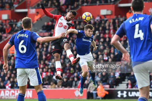 Southampton's Moroccan midfielder Sofiane Boufal fails to score with this header made under pressure from Everton's English midfielder Jonjoe Kenny...