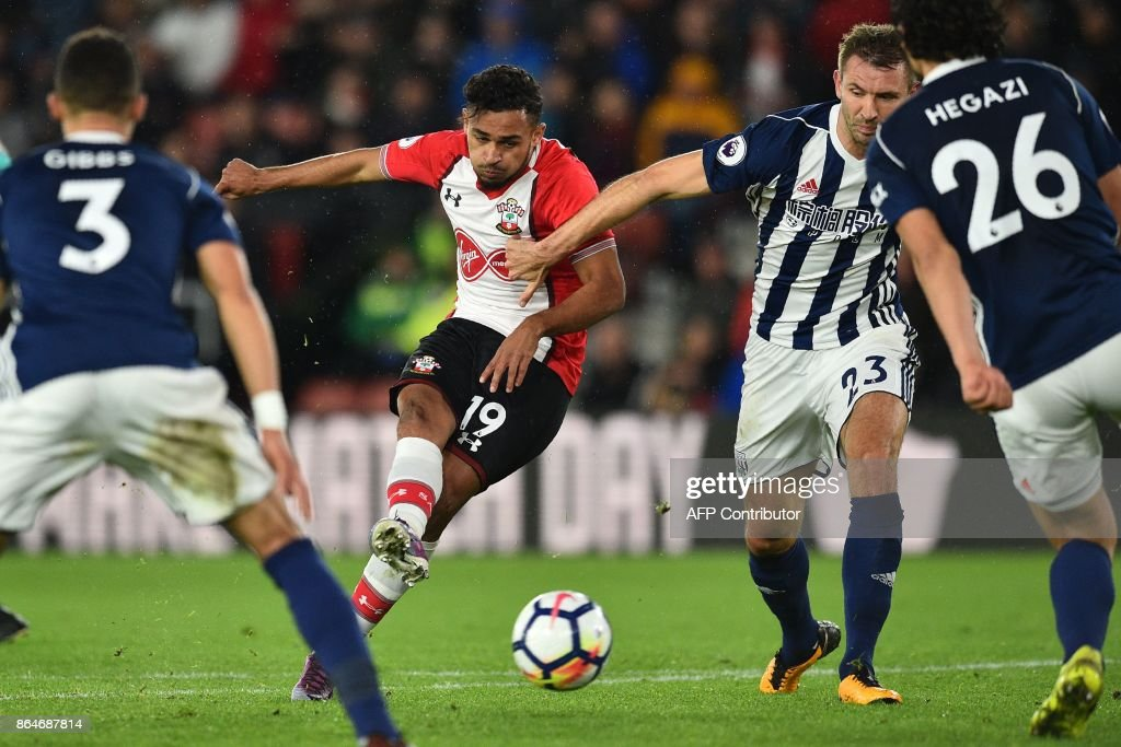 Southampton's Moroccan midfielder Sofiane Boufal (C) shoots to score the opening goal of the English Premier League football match between Southampton and West Bromwich Albion at St Mary's Stadium in Southampton, southern England on October 21, 2017. / AFP PHOTO / Glyn KIRK / RESTRICTED TO EDITORIAL USE. No use with unauthorized audio, video, data, fixture lists, club/league logos or 'live' services. Online in-match use limited to 75 images, no video emulation. No use in betting, games or single club/league/player publications. /