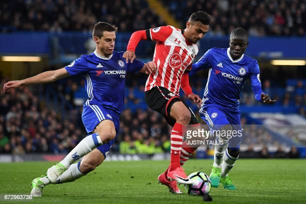 Southampton's Moroccan midfielder Sofiane Boufal vies with Chelsea's Spanish defender Cesar Azpilicueta and Chelsea's French midfielder N'Golo Kante...