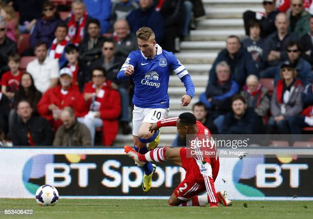 Southampton's Nathaniel Clyne slides in on Everton's Gerard Deulofeu