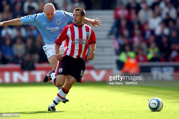 Southampton's Neil McCann and Manchester City's Danny Mills battle for the ball