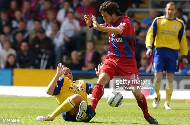 Southampton's Nigel Quashie tangles with Crystal Palace's Gonzalo Sorondo