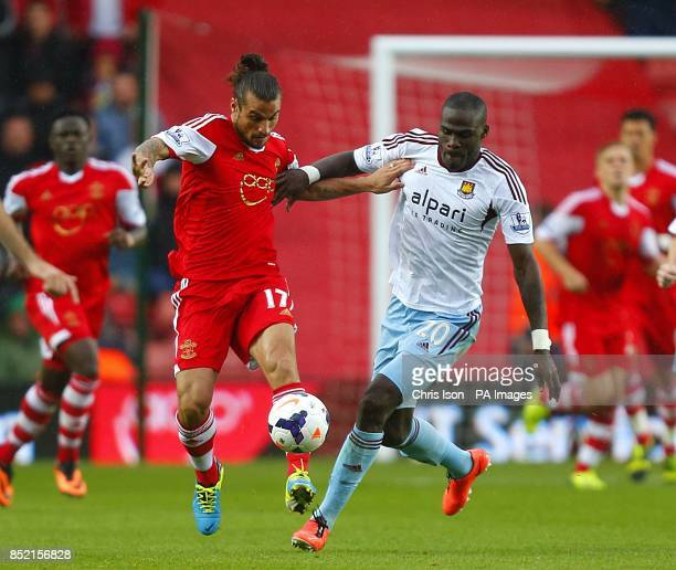 Southampton's Pablo Osvaldo and West Ham United's Guy Demel battle for the ball