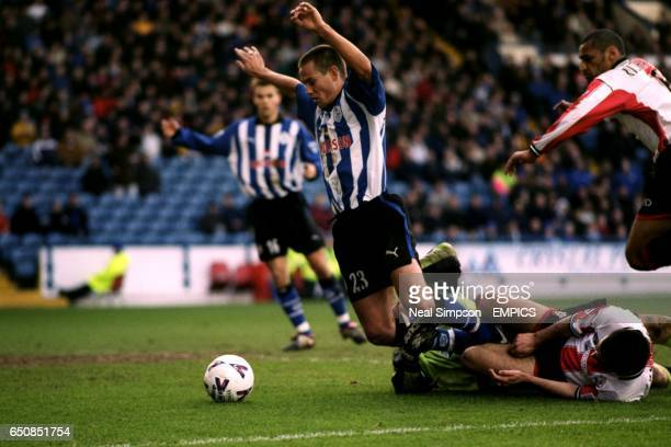Southampton's Paul Jones and Francis Benali concede a penalty by bringing down Sheffield Wednesday's Gilles de Bilde who then missed from the spot