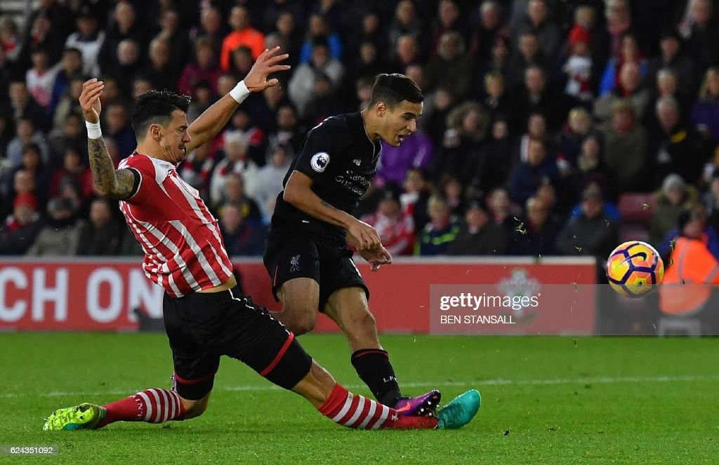 Southampton's Portuguese defender Jose Fonte (L) slides to tackle Liverpool's Brazilian midfielder Philippe Coutinho during the English Premier League football match between Southampton and Liverpool at St Mary's Stadium in Southampton, southern England on November 19, 2016. / AFP PHOTO / BEN STANSALL / RESTRICTED TO EDITORIAL USE. No use with unauthorized audio, video, data, fixture lists, club/league logos or 'live' services. Online in-match use limited to 75 images, no video emulation. No use in betting, games or single club/league/player publications. / The erroneous mention[s] appearing in the metadata of this photo by BEN STANSALL has been modified in AFP systems in the following manner: [Liverpool's Brazilian midfielder Philippe Coutinho] instead of [Liverpool's Brazilian midfielder Roberto Firmino]. Please immediately remove the erroneous mention[s] from all your online services and delete it (them) from your servers. If you have been authorized by AFP to distribute it (them) to third parties, please ensure that the same actions are carried out by them. Failure to promptly comply with these instructions will entail liability on your part for any continued or post notification usage. Therefore we thank you very much for all your attention and prompt action. We are sorry for the inconvenience this notification may cause and remain at your disposal for any further information you may require.