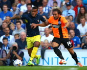 Southampton's Ryan Bertrand battles for the ball with Brighton's Inigo Calderon during the pre season friendly match between Brighton Hove Albion and...
