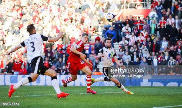 Southampton's Sam Gallagher scores his goal despite Norwich City defenders Steven Whittaker and Jonny Howson during the Barclays Premier League match...