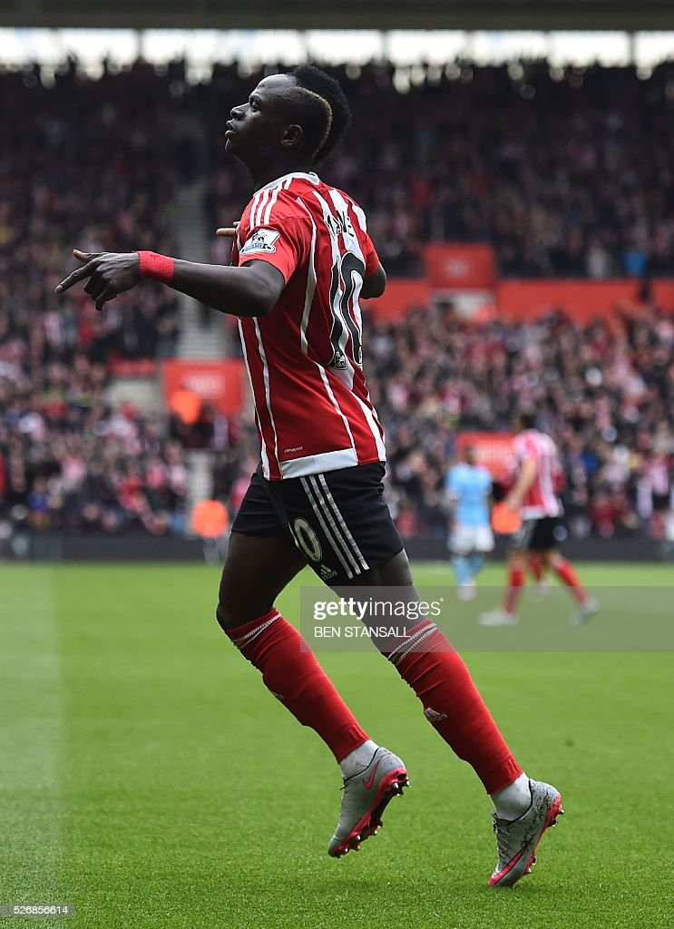 Southampton's Senegalese midfielder Sadio Mane celebrates after scoring during the English Premier League football match between Southampton and Manchester City at St Mary's Stadium in Southampton, southern England on May 1, 2016. / AFP / BEN STANSALL / RESTRICTED TO EDITORIAL USE. No use with unauthorized audio, video, data, fixture lists, club/league logos or 'live' services. Online in-match use limited to 75 images, no video emulation. No use in betting, games or single club/league/player publications. /