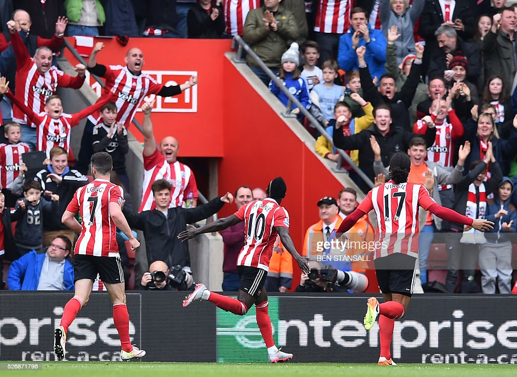 Southampton's Senegalese midfielder Sadio Mane (C) celebrates after scoring their third goal during the English Premier League football match between Southampton and Manchester City at St Mary's Stadium in Southampton, southern England on May 1, 2016. / AFP / BEN STANSALL / RESTRICTED TO EDITORIAL USE. No use with unauthorized audio, video, data, fixture lists, club/league logos or 'live' services. Online in-match use limited to 75 images, no video emulation. No use in betting, games or single club/league/player publications. /