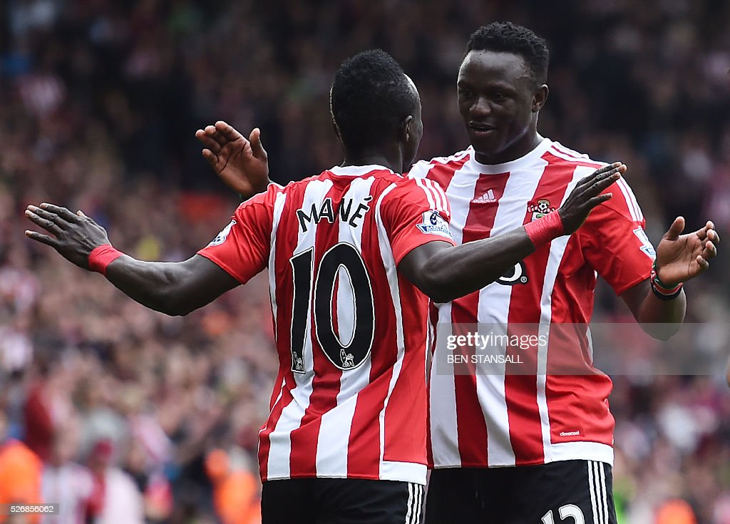 Southampton's Senegalese midfielder Sadio Mane (L) celebrates with Southampton's Kenyan midfielder Victor Wanyama after scoring their second goal during the English Premier League football match between Southampton and Manchester City at St Mary's Stadium in Southampton, southern England on May 1, 2016. / AFP / BEN STANSALL / RESTRICTED TO EDITORIAL USE. No use with unauthorized audio, video, data, fixture lists, club/league logos or 'live' services. Online in-match use limited to 75 images, no video emulation. No use in betting, games or single club/league/player publications. /