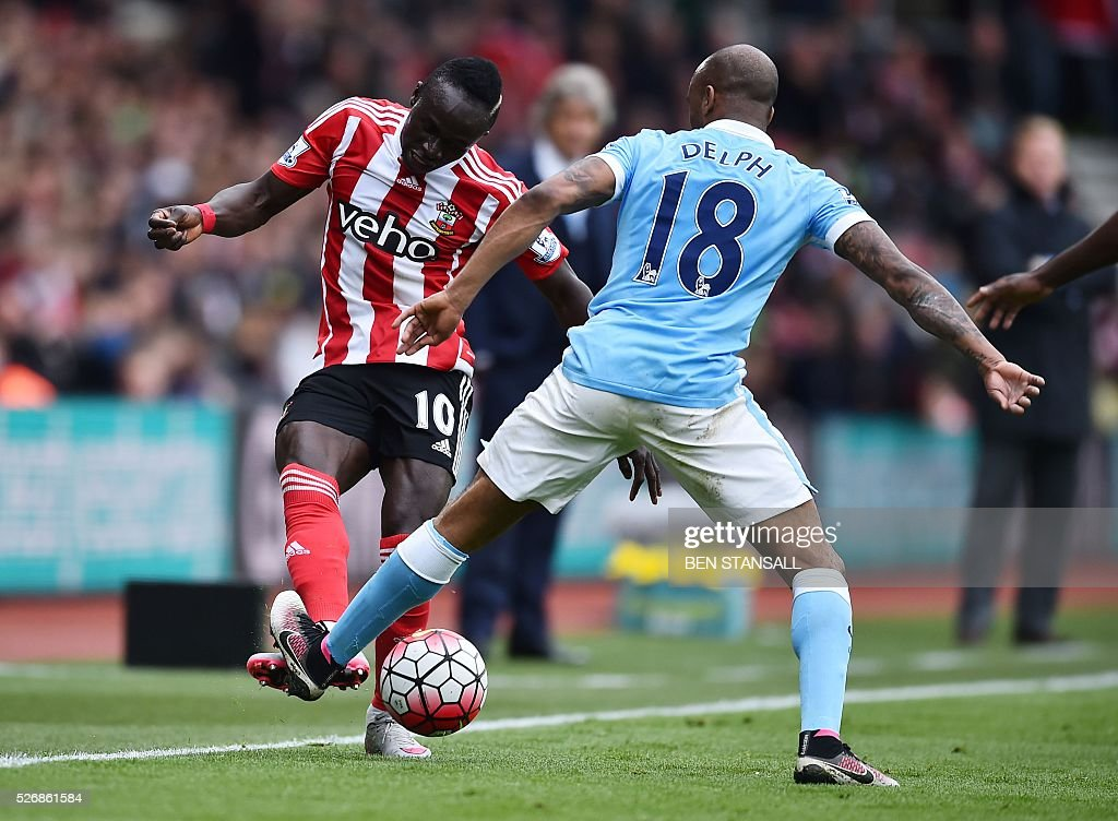 Southampton's Senegalese midfielder Sadio Mane (L) is tackled by Manchester City's English midfielder Fabian Delph during the English Premier League football match between Southampton and Manchester City at St Mary's Stadium in Southampton, southern England on May 1, 2016. / AFP / BEN STANSALL / RESTRICTED TO EDITORIAL USE. No use with unauthorized audio, video, data, fixture lists, club/league logos or 'live' services. Online in-match use limited to 75 images, no video emulation. No use in betting, games or single club/league/player publications. /