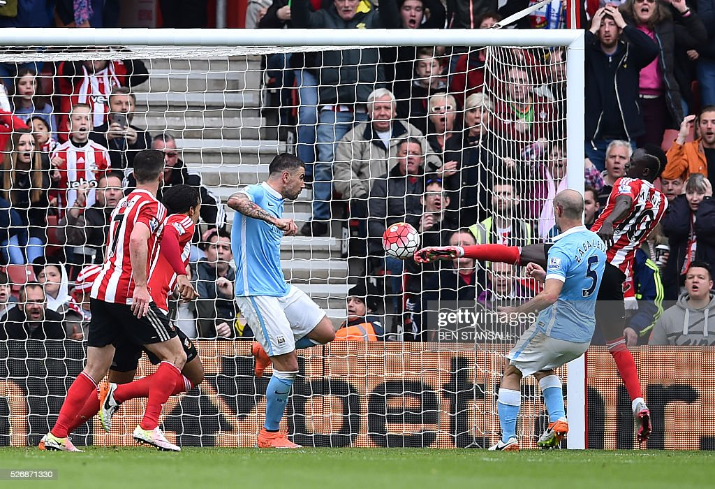 Southampton's Senegalese midfielder Sadio Mane (R) scores their third goal during the English Premier League football match between Southampton and Manchester City at St Mary's Stadium in Southampton, southern England on May 1, 2016. / AFP / BEN STANSALL / RESTRICTED TO EDITORIAL USE. No use with unauthorized audio, video, data, fixture lists, club/league logos or 'live' services. Online in-match use limited to 75 images, no video emulation. No use in betting, games or single club/league/player publications. /