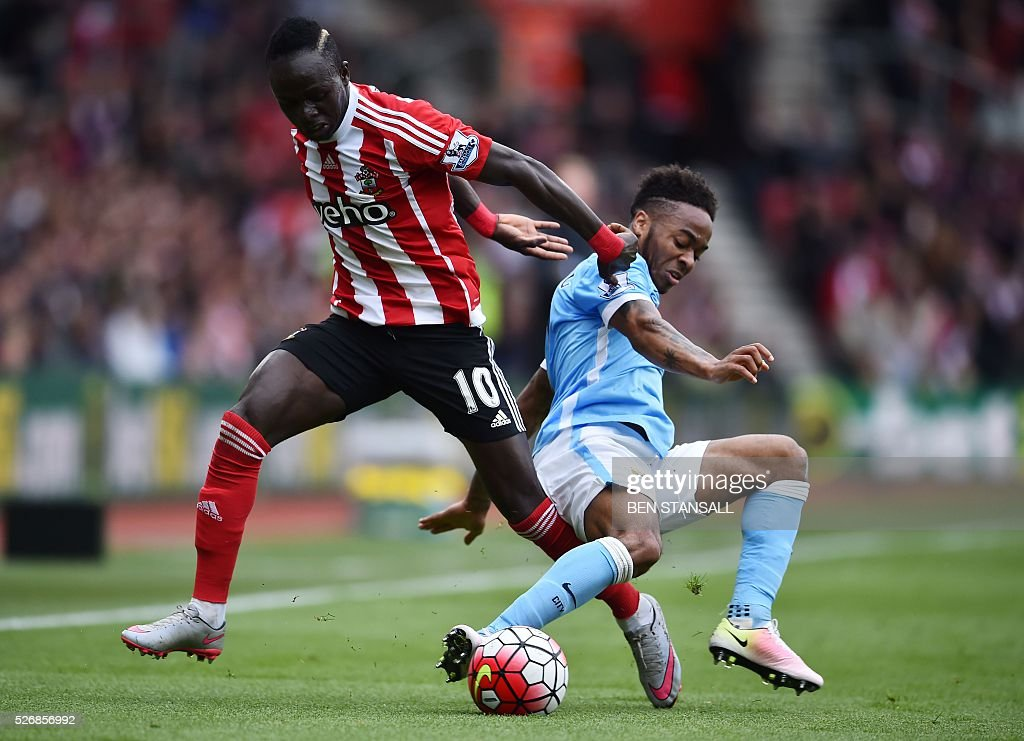 Southampton's Senegalese midfielder Sadio Mane (L) vies with Manchester City's English midfielder Raheem Sterling during the English Premier League football match between Southampton and Manchester City at St Mary's Stadium in Southampton, southern England on May 1, 2016. / AFP / BEN STANSALL / RESTRICTED TO EDITORIAL USE. No use with unauthorized audio, video, data, fixture lists, club/league logos or 'live' services. Online in-match use limited to 75 images, no video emulation. No use in betting, games or single club/league/player publications. /