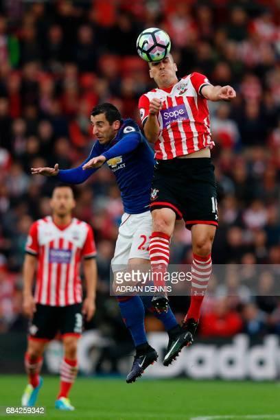 Southampton's Sepanish midfielder Oriol Romeu beats Manchester United's Armenian midfielder Henrikh Mkhitaryan in the air during the English Premier...