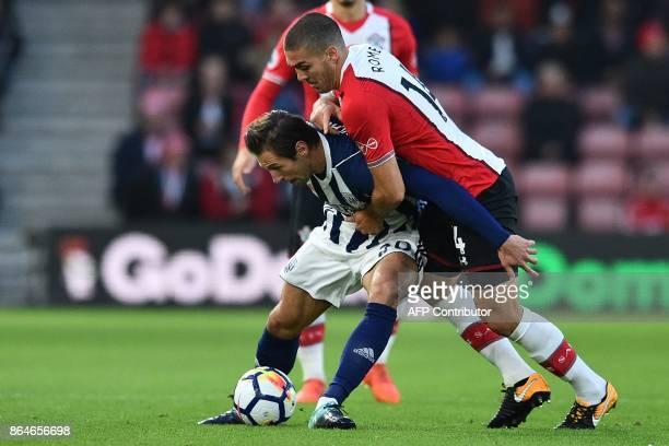 Southampton's Sepanish midfielder Oriol Romeu vies with West Bromwich Albion's Polish midfielder Grzegorz Krychowiak during the English Premier...