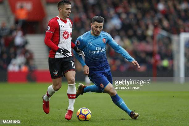 Southampton's Serbian midfielder Dusan Tadic vies with Arsenal's Germanborn Bosnian defender Sead Kolasinac during the English Premier League...
