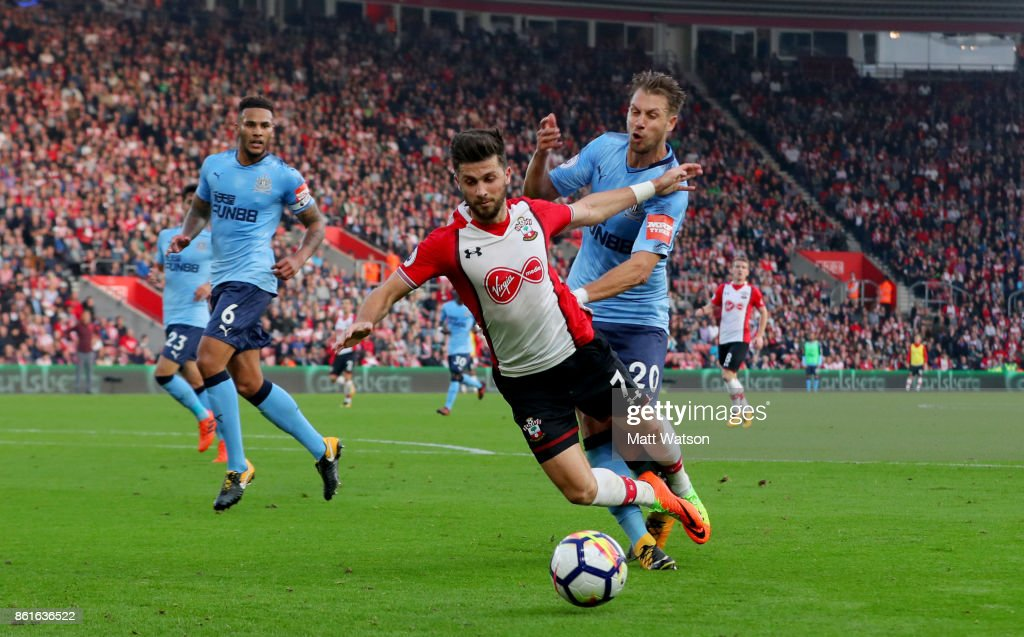 Southampton's Shane Long (centre) is brought down by Florain Lejeune to win a Penalty for Southampton during the Premier League match between Southampton and Newcastle United at St Mary's Stadium on October 15, 2017 in Southampton, England.
