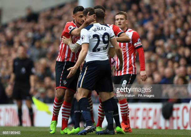 Southampton's Sofiane Boufal exchanges words with Tottenham Hotspur's Harry Winks resulting in a booking for unsporting behaviour during the Premier...