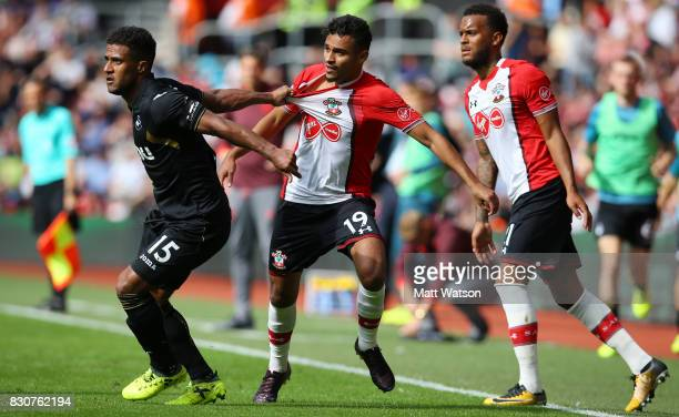 Southampton's Sofiane Boufal has his shirt pulled by Swansea City's Wayne Routledge during the Premier League match between Southampton and Swansea...
