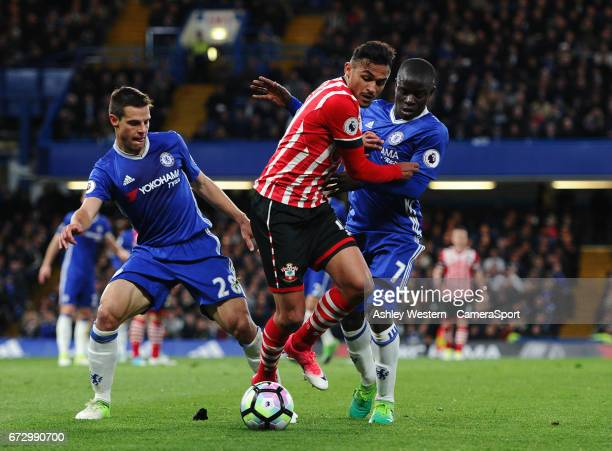 Southampton's Sofiane Boufal holds off the challenge from Chelsea's Cesar Azpilicueta and Ngolo Kante during the Premier League match between Chelsea...